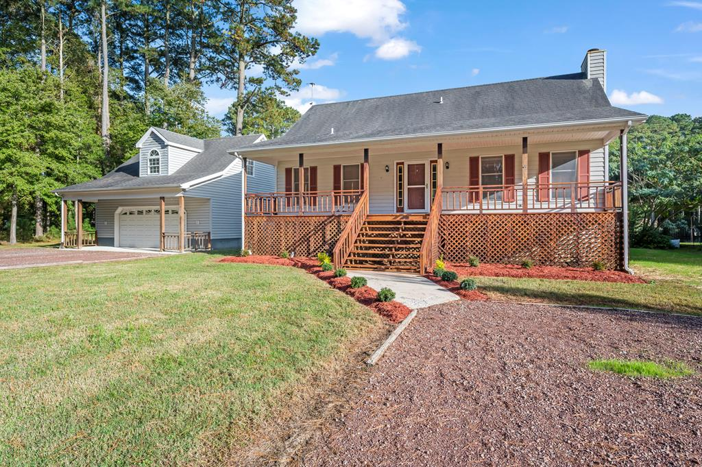 Gorgeous Pond Front Home is sprawled over 2 Lots - home is on this lot, & 2 car garage sits on 5A1-1-1129A. Property backs to Tidal Pond in your backyard - tons of wildlife - catch flounder, rockfish, & more, right here! Lovely Cape Cod has 3 Bdrms w/1st floor Master w/Master Bath. Huge Living Area has Brick Fireplace & leads to Sunroom, lining the back of the house. Spacious Eat-in Kitchen w/Solid Surface Countertops. Upstairs you'll find 2 spacious Bedrooms & 2nd Full Bath. 2 Car Garage sits on 2nd Lot w/Bonus Room- Backyard is amazing with Deck, Fire Pit, Tiki Bar - and OH, those views! Fence lining the property ensures waterfront safety, as well. Tons of space for your cars & water toys. Enjoy amazing Cove Amenities incl. 3 Pools, Golf, Fitness Center, Marina, 24 Hr Security, and more!