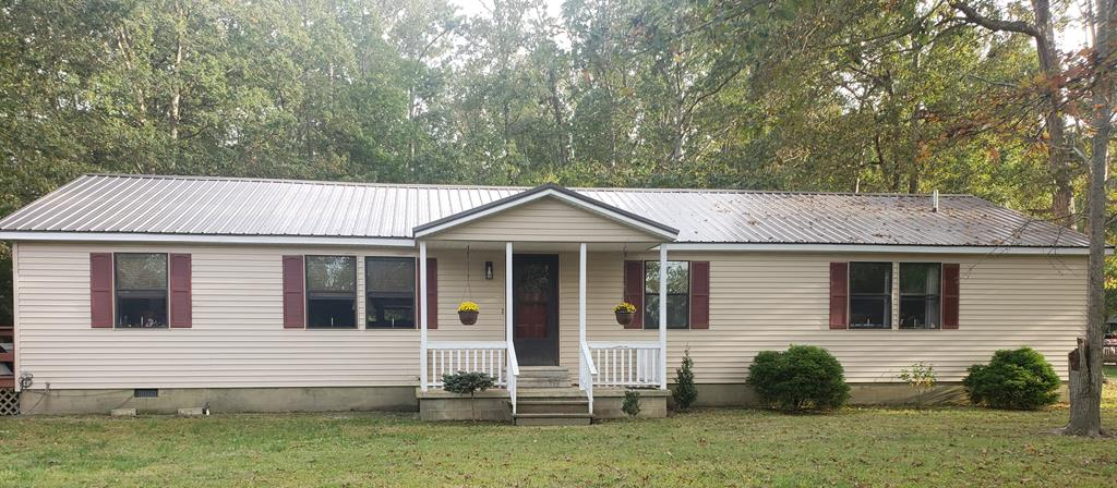 Located on a quiet street, this well-kept 3 bedroom, 2 full bath home features eat-in kitchen, dining room, living room, laundry room and large deck that wraps from the side to the back - perfect for entertaining - and is a MUST SEE! Home has metal roof and 2-Car Carport.