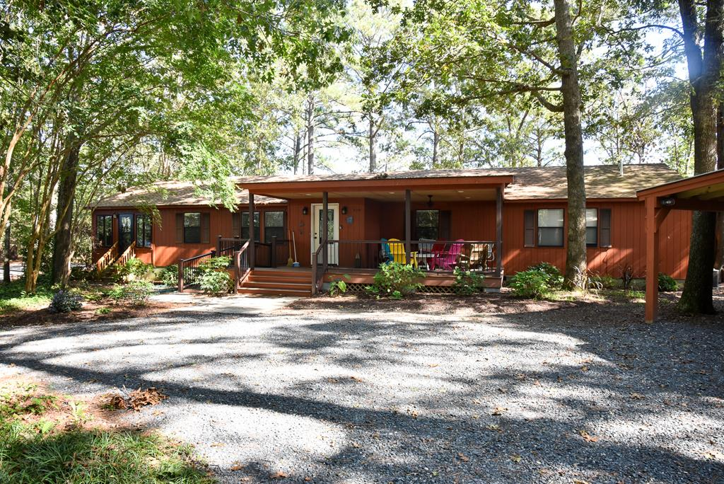 Private waterfront home w/ dock on 2+ acres overlooking pristine waters of Jacobus Creek. Quiet natural setting ideal for bird watching, kayaking, long walks, resting & relaxing. Perched on a wooded knoll, this well kept  1902 sq ft home has 3 br, 2 baths  w/ open concept living, Vaulted ceiling, huge brick hearth and fireplace, wood floors, private master suite, lots of storage, 2 enclosed sunrooms w/ panoramic water views & large back deck overlooking the water.   Lots of space for entertaining friends & relaxing w/ family. Detached 1 car garage w/ carport provides plenty of space for all your gear! A true getaway yet close to Cape Charles beaches shopping restaurants and marinas. Close to Norfolk International Airport and Tidewater area. Wilsonia has private boat ramp for residents.