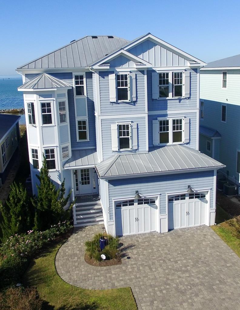 """Beautiful spacious beachfront home with elevator from the garage to the 3rd floor. Bay Creek Sports membership transfers to new owner! 3rd Floor- Over 1500 book Library with fireplace & built in file drawers, Stunning Master Suite with fireplace, endless views of the bay, enormous closet with laundry area, master bath with huge walk in shower also a guest suite with private bath. 2nd Floor-Main living area w/full kitchen, huge island, built in butlers pantry 5 burner gas stove, wall oven & microwave, a guest suite on 2nd floor & a half bath. 1st floor living area, full kitchen, mud room, full bath & guest suite. 5 ceiling fans, 4 55"""" tv's whole house networked together with 27 built in speakers & 2 surround sound rooms."""
