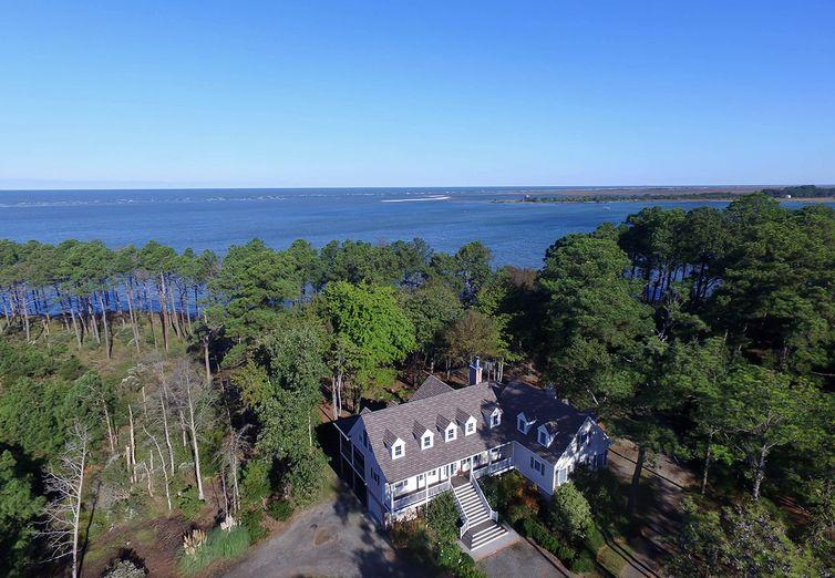 Chesapeake Bay beach, frontage on Craddock Creek & Bull's Cove, ponds, woods, field & marsh--Vineland has it all! 24 lot subdivision plus 7 additional tax parcels, private road, & managed forest make this perfect for investment potential, family compound, or conservation easement with tax advantage. With over 2 1/2 miles of coastline, most lots/parcels are waterfront. Estate house carefully sited & designed to maximize Bay views and sunsets. House beautifully appointed  to bring the outside in, multiple screened porches, master suite on first floor, elevator. OR buy all the land except for this lovely house and 23 acres, and build your dream house on one of the other magnificent sites. Hunting, fishing, boating, swimming, star gazing, basking in your own private nature preserve.