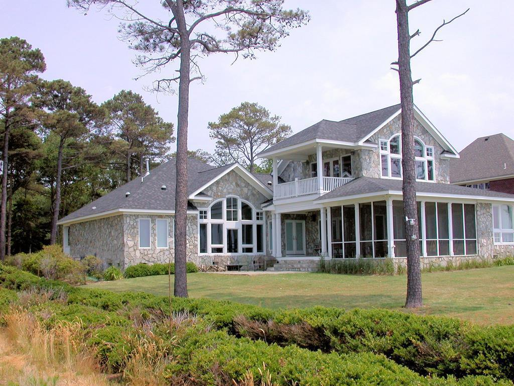 ALMOST 4000 SQUARE FEET OF EXQUISITE BEACHFRONT LIVING !  This  custom build home is situated on a bluff overlooking the confluence of the Chesapeake Bay and Atlantic Ocean. Open floor plan with widows galore for views of the bay from almost every room and first floor master bedroom and bath. Top quality offered through out: granite counter tops, custom mosaic backsplash, hardwood floors, office with wet bar, library with build in panel bookcases  Huge second floor great room overlooking the Bay with second floor porch. Exterior is maintenance free stone. This is the perfect home to start enjoying a relaxing coastal lifestyle and enjoying the pristine waters where the Chesapeake Bay and Atlantic Ocean meet. An easy  25 minutes commute to Virginia Beach and Tidewater area. .