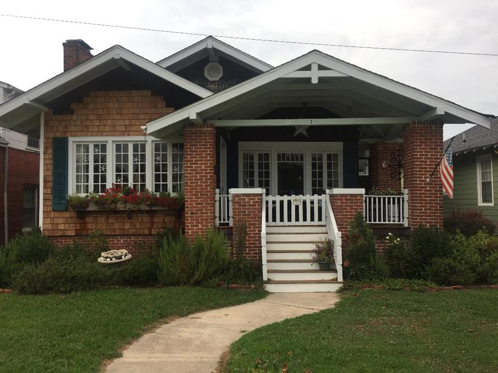 """Rare opportunity to own a charming craftsman style cottage overlooking the town park. This home has so much curb appeal with its cedar shake siding & attractive trim work, great front porch and lots of large windows.  Not often can you find a 2 bedroom """"first floor"""" suite home in Cape Charles. Original hardwood floors & trim through out, with open concept living and large fireplace in the living area. This home  has southern exposure which makes it feel very bright airy, and warm. The back yard has large deck, new fencing and its own drive way straight of Madison avenue for easy off-street parking and a large shed that could be turned in to a little guest cottage. You can sit on your porch in summer and listen to the summer concerts in the park. Easy stroll to the beach and downtown."""