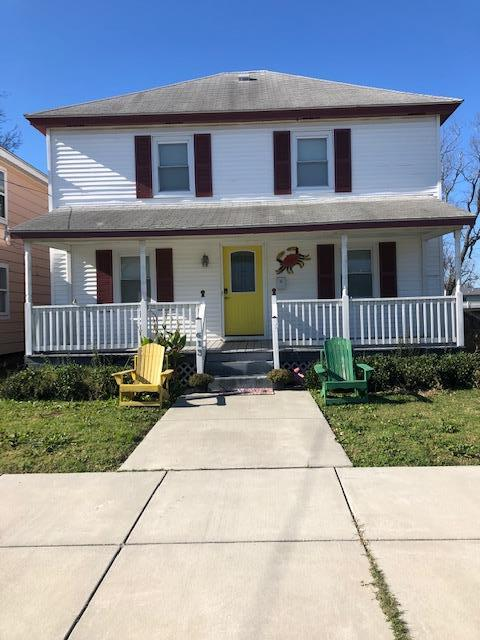 THE CRABBY PEACH is a great home on quiet street 3 blocks to beach & 2 blocks to town park. Peak-a-boo views of the bay from the upstairs windows. Hard to find FIRST FLOOR BEDROOM! 2 additional upstairs bedrooms sleeps 12 comfortably! Gleaming wood floors throughout first floor. Stainless steel appliances. Large deck, partially fenced yard. Recessed lights. Lever door knobs. Tile in both bathrooms including tub surround. Updated sewer lines, Trane HVAC unit. Open, bright with lots of natural light. Perfect second home getaway or would make a great vacation rental property that could potentially sleep 10-12.  Kitchen bar seats 4 + spacious dining area.