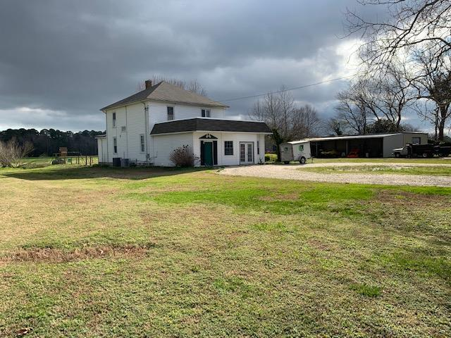 A four square farm house from days gone by, located on a 1 acre Lot which has an addition in the front that was used as a pet store. The property includes a 30'x60' work shop with a 20'x60' shed roof-overhang. Located on Hwy 13 in the Town of Cheriton. This home is a work in progress with a lot of critical items having been updated/renovated. Property is being sold as is; Ideal location as a primary residence with a serious work shop and storage or those 2nd home buyers looking for plenty of storage for boats, etc.. Convenient to Cape Charles with a public: beach; fishing pier, town park; stores, shops, dining, 2 marinas, golf course, seaside & bayside public boat ramps; (Note:This property is also Listed as 1 parcel totaling +/- 1 acre fronting on Hwy 13)