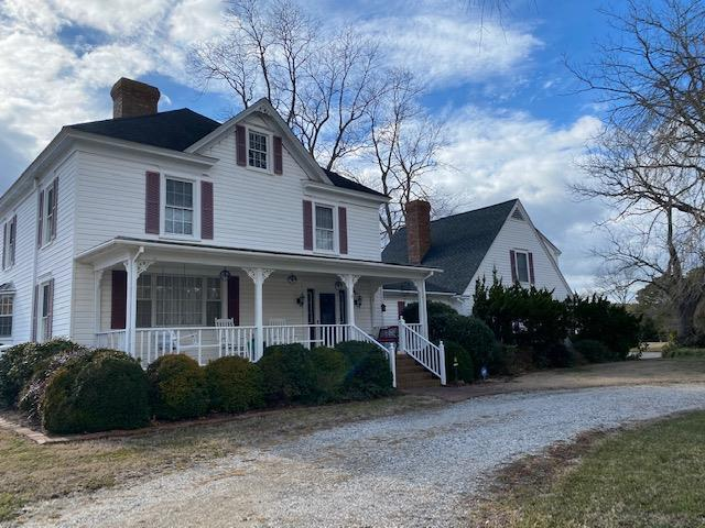 """Rare find - classic waterfront horse farm.  Just shy of 10 acres this lovingly cared for 3,000+ sf home has just about anything you could ask for.  2 pastures, 36 x 48 horse barn complete tack room, office, 4 stalls plus wash stall, hay/feed storage, 1/2 bath, attached 12 x 36 covered loafing area. In addition to an attached 2 car garage there are 2 vehicle storage buildings for your boat, RV, horse trailers, etc.  Restored 12 x 12 icehouse dating back to the early 1900.  Workshop,  Located on Finney Creek complete with dock, above ground pool with decking and pond. Home currently set up as 4 bedroom, but could be 5.  3 working fireplaces. Freshly updated kitchen with new appliances and granite 01/21.  Mature landscaping, fruit and nut trees - hence the name, """"Nutty Acres""""."""
