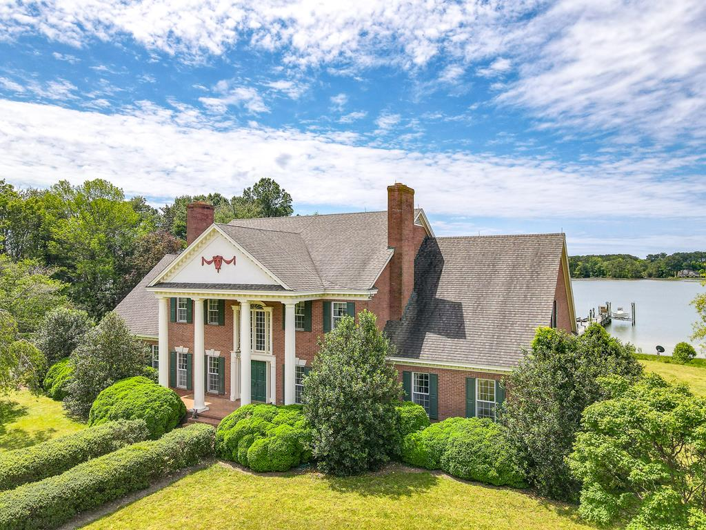 Sunset Bay Farm is a waterfront country estate located on Onancock Creek with views extending to the Chesapeake Bay. Comprised of 72 acres that include pasture, private yard, and woods-land. The main house is classic Georgian style architecture with over 6,000 square feet of living space. Special features include, 9ft ceilings, wet bar, private office/study, game room, & 4 fireplaces. Outside enjoy the In-ground pool, wrap around deck, sandy beach and private pier with 2 boat lifts. Additionally there is a 36x72 Barn with attached 72x210 indoor riding arena; ideal for the equestrian but also easily adaptable to use for whatever your need is. Guest house/Apartment offers two additional living spaces, for guests and/or caretaker. Priced below Sept. 2020 appraisal!