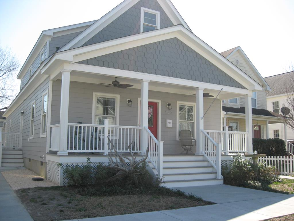 Beautiful custom built 3 BR, 3 bath home w/ hickory floors, lots of windows, off street parking & low maintenance exterior. Offered furnished. Centrally situated in towns historic district, close to beach, central park, dining, harbor & shopping. Open concept kitchen, dining & living area. Gourmet kitchen w/ stainless appliances, quartz countertops & walk-in pantry. 1st floor owner's suite features bath w/ pocket door, bidet, tiled walk-in shower, double sink & walk-in closet. Den & laundry room on 1st floor w/ large Rec. room, bathroom & 2 BRs on 2nd floor. 2nd floor Rec. room wired & plumbed for full kitchen w/ separate entrance (possible apt. or in-law suite). Detached garage & off-road parking on back alley. Side fenced yard. Screened back porch & open front porch. Rinnai hot water.