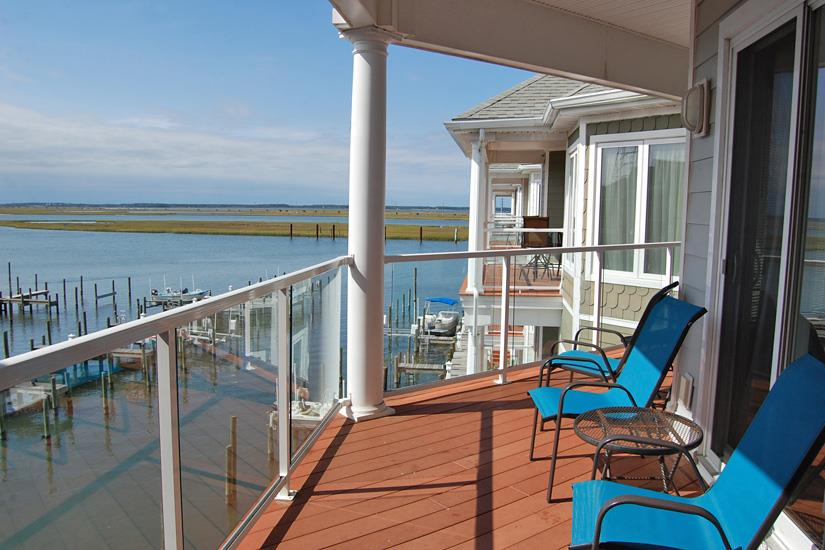 Luxurious Waterfront Condo boast Panoramic views of the Chincoteague Channel. Catch the year round beauty of the Famous Chincoteague Sunset from  the over size balcony. Offered fully beautifully. This property would make an excellent second home/vacation rental.  Living room offers wonderful open floor plan with oversized sliders. The kitchen features granite counter tops and maple spice cabinets. The living room features a cathedral ceiling, The main bedroom features access tot he balcony and on-suite w luxurious deep jetted tub, tiled separate shower & his/her closets. Amenities include pool, fitness center & attached storage room.