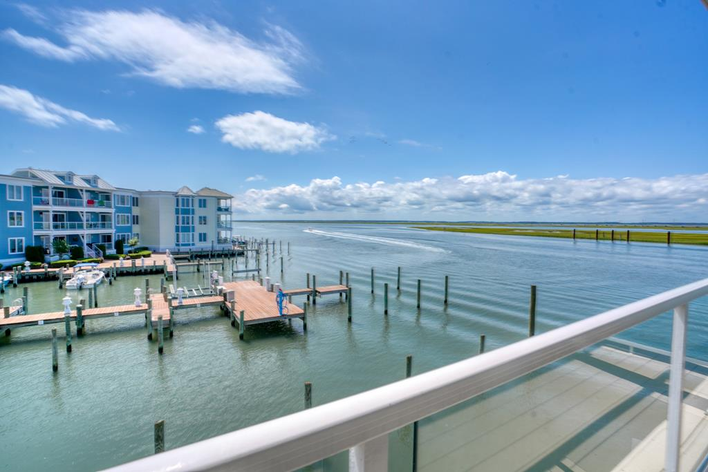Sunset Bay Villa w/ BOAT SLIP! This 3bed, 2 bath end unit has amazing views to the North & South of the Chincoteague bay. It boasts the largest deck layout in the development at 271 square feet, w/ access from the living room & owners suite. This unit offers year round, breathtaking sunsets as well as a front row seat to watch the fishing boats & dolphins as they pass by! The open floor plan is great for entertaining & provides lots of room for you & your guests to enjoy. Other features include a large breakfast bar, tile flooring in the kitchen & baths, & owner suite w/ a tray ceiling, moldings & a whirlpool tub. Community amenities include an individual storage unit, crabbing & fishing pier, swimming pool & an exercise facility! W/in close proximity to beaches, shops, restaurant & parks!