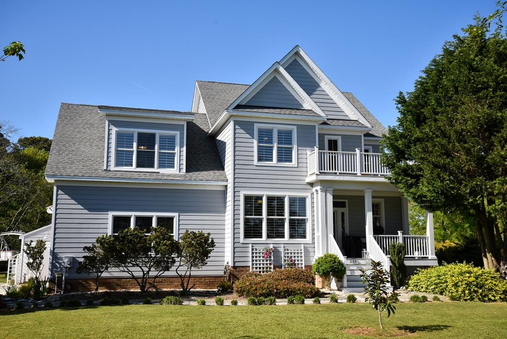 Nestled in the back of a private shell driveway sits this lovely appointed custom home. Listen to the birds on this immaculate mature landscaped property. Perfect for outdoor living! The house offers lots of natural light with a generously sized back porch/large balcony above & a balcony to the front. From your back yard take a leisurely walk on the nature trails over to the boat docks. This property comes with an assigned dock as well. The house has beautiful hard wood floors through out, custom kitchen, gas log fire place, ship lap, build-ins and large sliding glass doors. This home can be purchased with the property next to it, which has stunning water views up the creek and is lovely landscaped plus second boat slip. Great location just outside of Cape Charles. Community pool & tennis