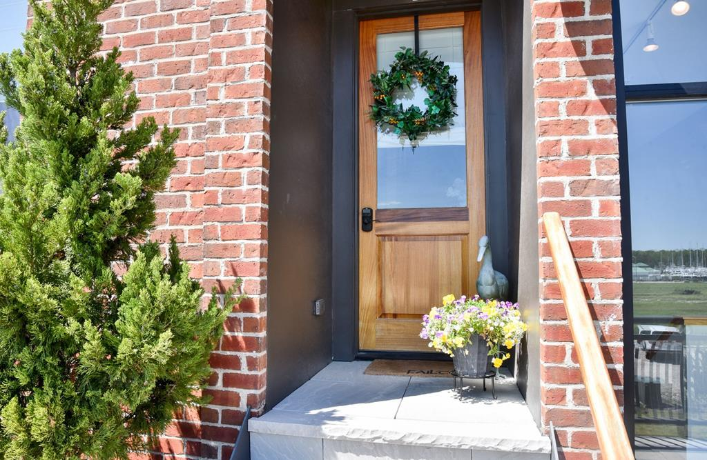 One year old Townhouse with amazing views of the Chesapeake Bay! Wake in the morning to the Sun glistening on the harbor or sit out on your balcony overlooking town. Offering  open concept Living Room, Dining Area and Gourmet Kitchen with granite and upgraded appliances. Island with seating for 4. Laundry Room off kitchen with added storage space. Convenient half bath on first floor. Second level offers 2 bedrooms, 2 baths. Main bedroom has 2 walk in closets and en-suite with large shower. Overlooks the Harbor and Chesapeake Bay. Front bedroom overlooks town. Access to hall full bath with combination tub/shower. Living Room offers exposed duct work and brick wall for an urban feeling. Very reasonable Condo fees include water/sewer/trash. Townhome is assigned 2 parking spaces.Walk to Beach.