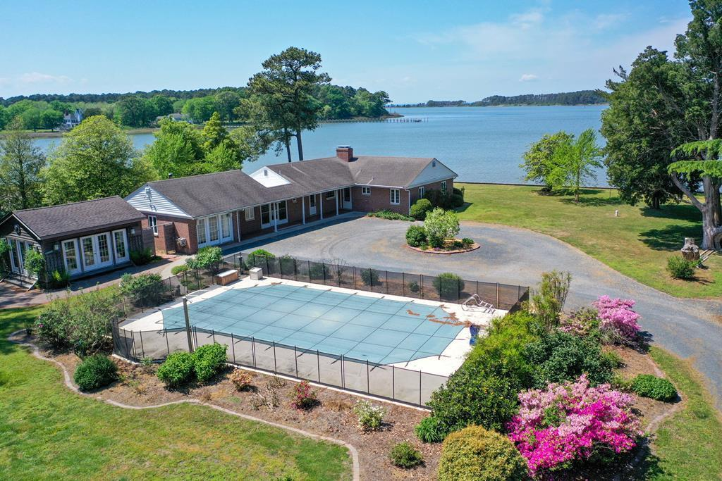One of the best views on the Eastern Shore.  Recently new bulk heading was put in and some rip rap on the main body of the creek.  Dock, with new decking, is in a protected setting with moderate water.  In ground swimming pool with newer pool house.  Entertaining is easy with all the amenities.   Garage has a studio/work shop overlooking the water.  Newer kitchen with stainless steel appliances with good sized eating area.  Opens into the enclosed breeze way.  Dining area has two big windows that allows you to watch the sunsets as you have dinner.  LR - large window overlooking the water and for those cool evenings a fireplace insert .The gardens have loads of perennials  that add a splash of color.  Whole house propane generator. Buyer's  agent RE commission to be paid by Buyer