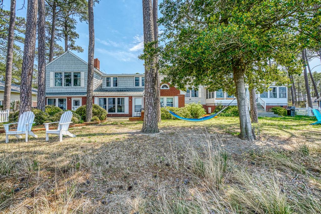 ENJOY SPECTACULAR SUNSETS OF THE CHESAPEAKE BAY FROM THIS 4000 SF HOME.  COULD BE USED AS MAIN HOUSE AND ATTACHED GUEST HOUSE.  POSSIBILITIES ARE ENDLESS. CURRENTLY USED AS 2 AIRBNB'S WITH HISTORY OF RENTALS YEAR ROUND. PATIOS FOR RELAXING OR TAKE A SWIM ALONG THE SANDY BEACH.  DEEP WATER MARINA IN COMMUNITY. CENTRAL HEAT/AC IN BOTH UNITS.  ORIGINAL REAL WOOD PANELING WITH 2 FIREPLACES AND ENCLOSED PORCH FOR COOLER DAYS.  METICULOUSLY MAINTAINED IN ESTABLISHED WATERFRONT COMMUNITY. THERE ARE MANY MORE ROOMS THROUGHOUT THE HOME!!!  LOTS MORE INCLUDED IN THIS WATERFRONT HOME!  CALL FOR DETAILS.