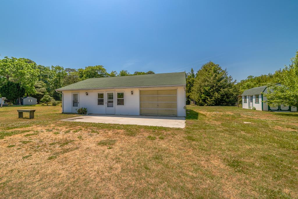 This home is the perfect spot for a fisherman's getaway or a full time residence. Located on a quiet street off of Sunnyside Road, the home sits back from the main road and features a large front and back yard complete with a garden plot and an abundance of fruit trees. The inside includes a large primary bedroom with a full bath. The living space is an open concept that that includes a dine in kitchen as well as space to dine at the bar. A large garage space can be used as a secondary bedroom or a bonus room. The rolling garage door makes for easy access to work on all of your boat and vehicle projects. In the back of the home find a laundry room with a separate entrance, full size additional refrigerator, and a full private bath. Centralized location for Seaside and Bayside boat ramps.