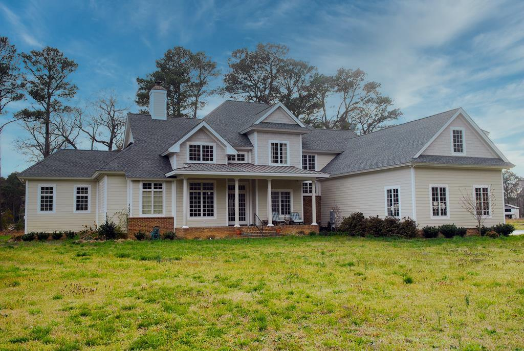 """""""Chateaux Of Lake Allure"""" This contemporary 4000+ sq. ft. lakefront home is from the Sater design collection. Chef's kitchen with wood mode cabinets, high end appliances, granite counter. 24 ft tray ceiling in living room, cathedral ceiling in office, 14 ft ceilings in kitchen & bedrooms. 7 high end oversized French doors, top of the line casement windows, hardwood floors, slate and ceramic tile through out the entire house. Spa like first floor bathroom, slate covered porches with copper porch roofs in the front & rear and chimney top. 3 door garage, all this on a beautiful 5 acre private lot overlooking lake Allure with its incredible wild life. Beach access. 10 minutes south of Cape Charles, 30 minutes to Virginia Beach.Photos are 12 years old. Oven 48 inch Blue Star, Fridge kitchen aid"""