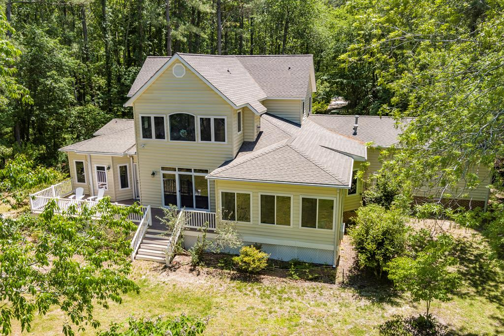 Serenity, Nature, Water, Beach, Wildlife comes to your mind when you drive up to this beautiful 4 bedroom waterfront home nestled in the back of its private driveway. Located at the cul-de-suc of the Sugar Hill beachfront community this custom home sits on a 2.56 acre waterfront lot overlooking Elliots Creek & the Chesapeake Bay. The interior of this custom home has a comfortable lay out with lots of natural light. First floor bedroom suite, hardwood floors & tile through out the entire home, large kitchen and a sunroom leading to the back deck. Home is sold furnished including art work, dishes and linens. This home is located 10 minutes south of Cape Charles and minutes form the CBBT. Great for a primary home with a 30 minute commute to Virginia Beach or vacation home, Vacation rental.