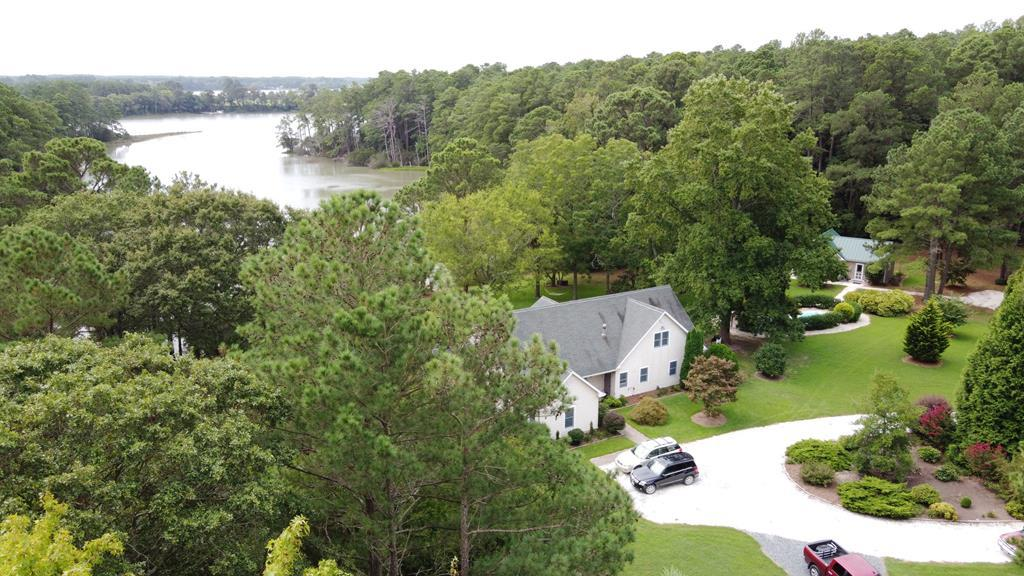 Everything you could ever desire on a secluded 7.828 acre peninsula!  This custom built Jamesville 3 bedroom, 3 bath home overlooking Nassawadox Creek has it all!  A dock for your boat.  A 28' in ground salt system pool.  A detached garage with workshop and an extra 30' x 14' x 12.8' bay for your RV or boat.  But wait there's more, an adorable 569 sf 1 bedroom, 1 bath guest home that comes completely furnished.  Use it for guests or vacation rental as the current owners have.  Property features deep well, 2 septic systems, a dump station, and 2  30 amp RV hookups. Want to telecommunicate to work - you can, Reddtip high speed Internet service installed.  Owners have attended to every little detail and spared no expense.  Come explore this Utopia on the Shore.  Measurements are approximate.