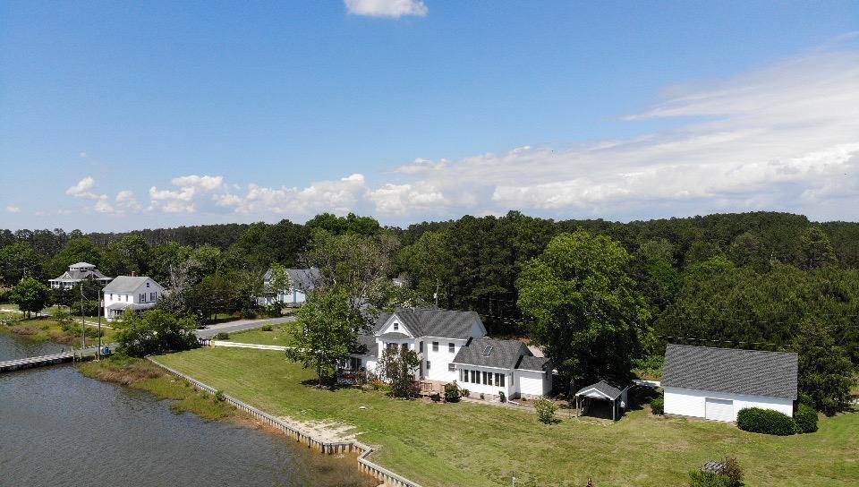 This is a beautiful property right on the water (approximately 365 ft of waterfront), new vinyl bulk head, approximately 60 ft dock, spacious home recently remodeled, 2 1/2 garage, workshop (2), carport, 2 decks and more.  This home is being used as a 4 bedroom with a master bedroom on each floor and has 4 1/2 bathrooms.  Very roomy home.  High end finishes.  This is a must see.  Call today for a private showing of this great property.