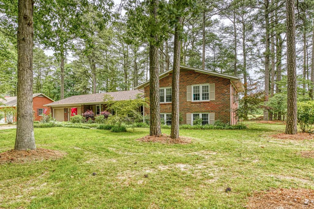 RELAX AT YOUR LAKE FRONT RETREAT - LOCATED IN ONLEY. IF YOU HAVE A LARGE FAMILY, THIS BEAUTIFUL BRICK SPLIT LEVEL OFFERS ENOUGH ROOMS FOR EVERYONE.  LARGE BASEMENT HAS REC ROOM, OFFICE AND BEDROOM.  MAIN LEVEL HAS SUNROOM AND DEN THAT OVERLOOK THE LAKE. LIVING ROOM AND FORMAL DINING ROOM.  3+ BEDROOMS AND 3 REMODELED BATHROOMS, COULD BE USED AS A 5 BEDROOM HOME!  WANDER DOWN THE QUIET STREET, WATCH THE KIDS RIDE THEIR BIKES OR GET THE FISHING RODS READY FOR A DAY OF FISHING. GREAT FAMILY NEIGHBORHOOD. EXTREMELY WELL MAINTAINED! CONVENIENTLY LOCATED NEAR SHOPPING, SCHOOLS AND RESTAURANTS!!  LOCATION, LOCATION, LOCATION!!!