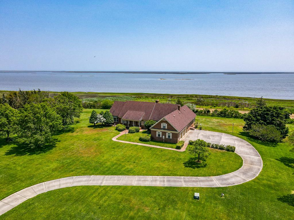 Ever dream of watching the sun rise? Here is your chance to do it every single day. This private seaside estate is sited on over 230 acres, inclusive of a pond, tillable land and woods. Ideal for hunting; ducks, deer, turkey, & rabbit. Built in 1995 this home was one of the finest of its time. Extras include a whole home diesel generator, private home office with built-ins, first floor master suite, and multiple fireplaces.  Ample storage space with a full, walk-in attic that could be converted to additional living space if desired. 3 Car attached garage. Hardwood floors. Additional rooms include a designated craft room, sun room, dining room, den & formal living room. Private. Rural.