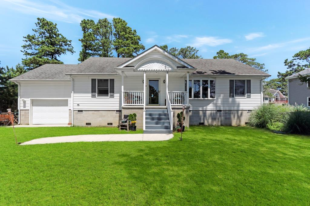 This beautiful single level ome is nestled at the end of a canal in the serene and peaceful Richard's Landing Community. Offering one level living with 3 bedrooms, 2 bathrooms, a beautiful sunroom looking over the water and semi-open floor plan will make this your perfect island retreat or primary residence. This home is a nice and high block foundation and features an attached garage as well. You'll love launching your kayaks and canoes from the backyard and paddling out to the waters of Oyster Bay where you can make ways to Assateague Island and so many other great locations. This home would also make a great vacation rental to help absorb some of the cost of ownership all while allowing you to still enjoy it. Come take a look today!!