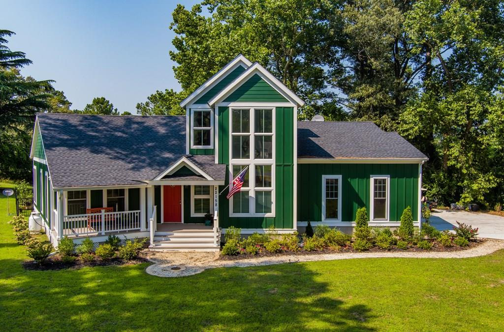 """Waterfront contemporary home w/ boat slip in Kings Creek Landing was built in 2020.  Architecturally designed coastal home w/ open concept living has lots of floor to ceiling windows & hickory floors thru out. Private natural setting amidst tall pines provides respite from busy Cape Charles just 2 miles away! 16'6""""x 11 screened porch. Expansive 1st floor ensuite has double walk in closets & quiet views of the water. Bath has huge whirlpool tub w/ separate tiled shower. Upstairs there is an additional 2 bedrooms w/ Jack & Jill bath. Back bedroom has expansive water views from ample 2nd floor deck overlooking Kings Creek. Attached double car garage has (2) 200 amp electric panels and hook up for whole house generator. 5 minute boat ride to the Chesapeake Bay, Oyster Farm Restaurant & C Pier."""