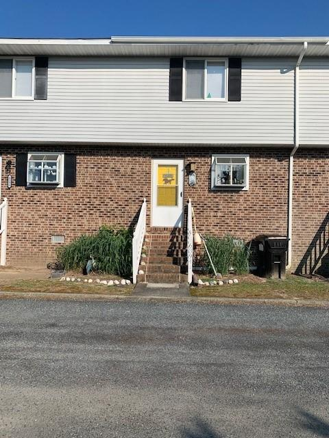 This well maintained waterfront townhome, overlooking Little Oyster Bay, is move in ready! Private community water access with a dock just outside your back deck. Put out the Kayak or drop out the lines to catch some crabs. Home has a large eat in kitchen with a nice size living room, deck off the living area and 1/2 bath on first floor. There are two bedrooms each with a private bath on second floor. New roof in 2019 and new drain fields. The association maintains the septic system. Great location within minutes to the entrance of Assateague and walking distance to restaurants, shops, and entertainment for the family.