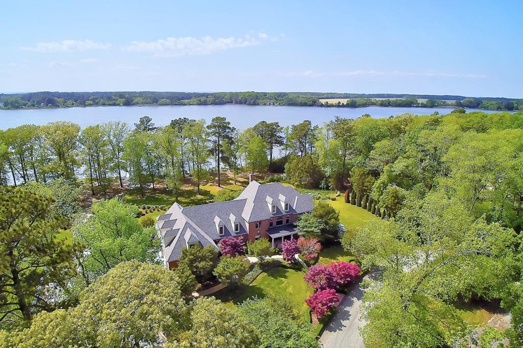 Extraordinary property is the best of both worlds for boaters & equestrians! Adjoining parcels. 7.84 AC (4375 White Tail Ln) hosts primary residence with gorgeous views from all rooms, pier & lift on deep water. Addl. 7.47 AC parcel (12052 Waters Edge Ln) with 10 stall barn, tack room, wash & feed areas, apartment, full-size indoor arena, spectator area & equipment storage. Floor plans available. Main home 3 levels: 1st-floor primary suite, library, great room, butlers pantry, elevator to 4th-floor attic. Apartment with separate entrance & full kitchen, full bath, bedroom & living room. 6 zone geothermal HVAC, mechanical room. Full appliance package in both living areas including laundry for an apartment. Must be seen to fully appreciate the many amenities this property offers.