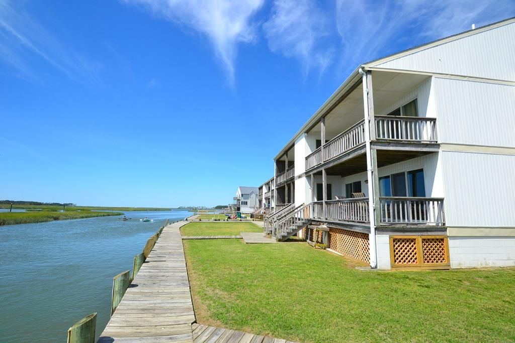 The moment you step into this beautifully appointed waterfront condo you will fall in love. The cozy open floor plan provides a great kitchen, dining space and living room that walks out to a spacious deck overlooking Assateague Island. The sprawling views offer some of the best parts of Chincoteague Island, from the wildlife, the watersports, ponies and more. This second story condo also offers 2 large bedrooms, 2 full bathrooms and laundry in the unit. You do not want to miss this opportunity.