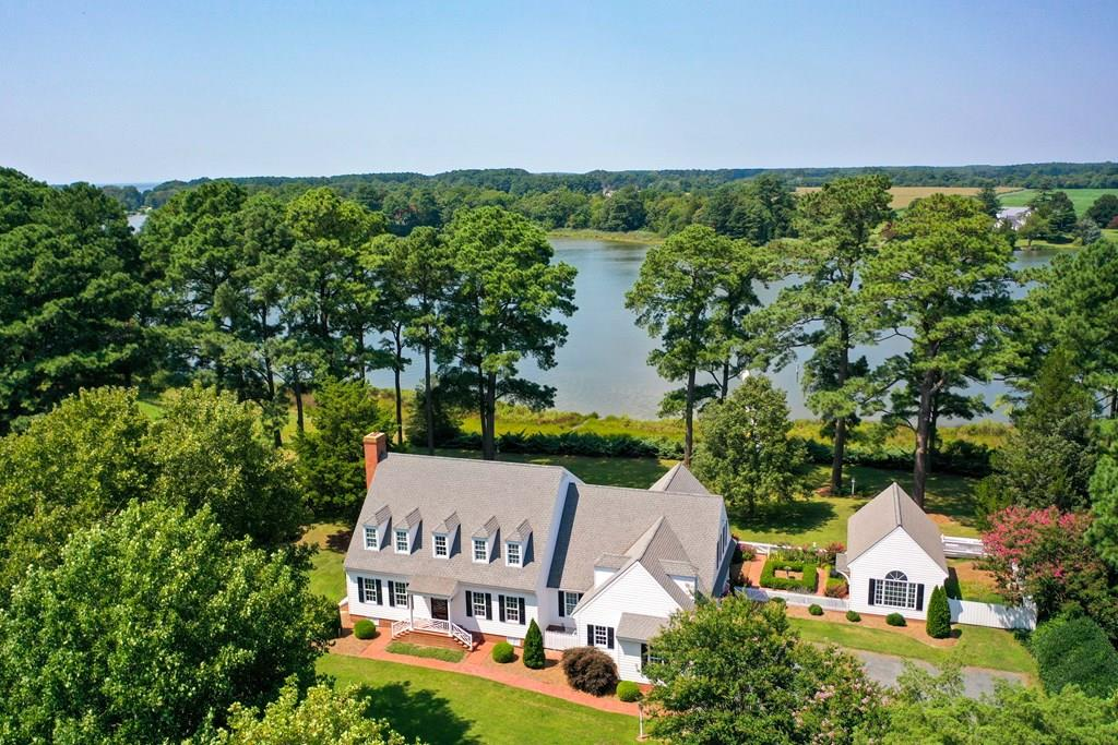 If you are looking for a spectacular custom-built home on Onancock Creek, this is your opportunity. This home was designed by William Poole, architect for Colonial Williamsburg fashioned after the Barraud house in Williamsburg. Every inch of this home has been well thought out. The grounds have been beautifully landscaped all the way down to your private dock with deep water depth. You will no longer have to wonder what it would be like to have sunset views because now you will have them every day. This home is located very close to town, where you can take care of your shopping needs, dine in local restaurants, see theatrical performances, visit local art galleries and you will also be close to the local hospital as well.  Plan your visit and don't let this home slip from your fingers.