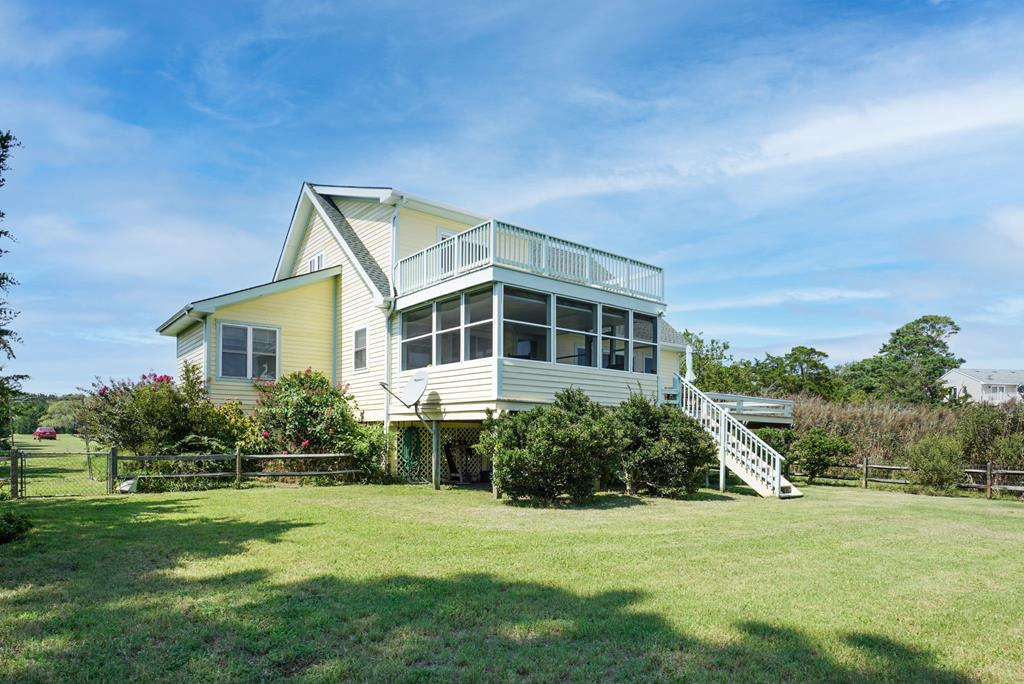 A gentle seabreeze and a sense of privacy envelops this home and magnificent property as you turn into the drive.  Located on the Seaside of Virginia's Eastern Shore, overlooking Cross Creek and the Barrier Islands beyond, Cross Creek Cottage is a sweet retreat happily situated among indigenous natural plantings and established landscaping.  With 3 Bedrooms/2 baths and an open floor plan, this home is the perfect year around beach house, vacation rental or single family home.  Live with generous spaces inside and freedom to enjoy access to Metompkin Bay and Barrier Island beaches from the private dock or from the multiple porches and decks.   Sunrises overlooking the water and rocket launches from Wallops are all part of the package. Chincoteague Island and Cape Charles are a short drive.
