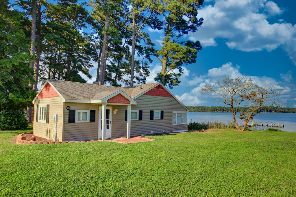 Looking for that private getaway on the water?  Look no further than this 2 BD / 1 BA rancher with STUNNING views of the Occohannock Creek.  This property sits on about of acre of land and features a MASSIVE 2 car detached garage that is large enough to store your travel trailer and vehicles.  Take in the views from the private boat dock or from the enclosed glass window porch.  Would work great as an investment property or go in with a few friends and share the view at your leisure!  The deep channel of Occohannock Creek will allow almost any boat to travel out in to the Chesapeake Bay.  Roof is less than 5 years old.  Call today for your private showing or check out the 360 degree virtual tour!  What are you waiting for?  That getaway you've always wanted has never been closer!