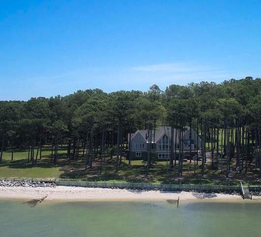 THE SANDCASTLE is an EXQUISITE 5000+/- sq.ft. LUXURY BEACHFRONT DREAM HOME and one of the very finest beach homes on the Shore! This custom built ICF 4 BD, 3  BA home, with widows galore, has all the bells and whistles one could want! Bright, Open & Airy 4 zone floor plan w/ huge Great Room w/ vaulted ceilings with a dramatic wall of windows overlooking the water, Gourmet Kitchen with solarium windows, DR w/ French doors leading to a splendid back deck, large Family Room, cozy Library w/gas fireplace, built-in bookcases & its own private deck. Master BR w/ spa type Bath and balcony. 3 bedrooms, 2 baths and media room on 3rd floor. Lower level has huge rec room & wine bar with seating. 1 extra lot conveys as well. New 50 yr roof. No HOA. Owner/agent. Excellent vacation rental income.