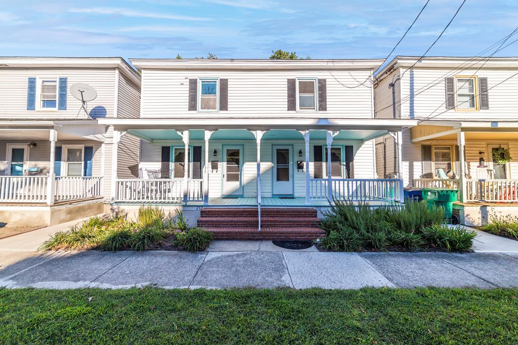 Three short blocks to the beach and right next to Central Park! Two bedroom, one bath home on each side. Ideal for vacation rentals. Handsome wood floors, replacement windows, new roof and updated kitchens and baths!!