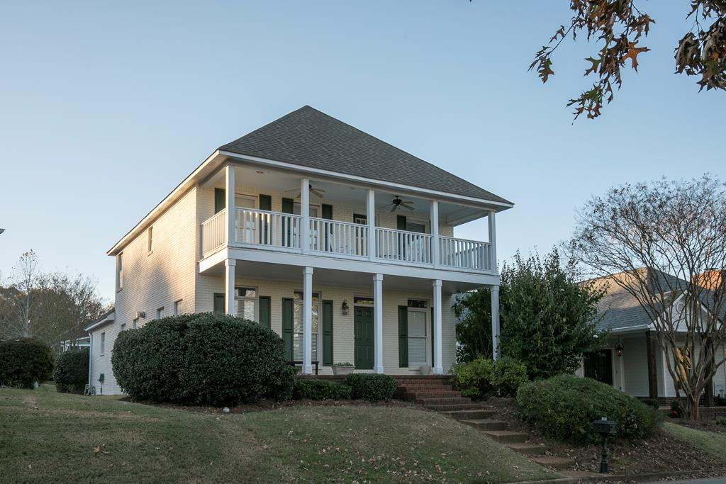 Southern charm & convenience in this St. Charles Place home. Just a little over 2 miles from the Oxford Square! This home boasts 2 fabulous porches, a large downstairs master, lovely open living and dining connected by a gas fireplace, excellent space upstairs, large storage closets, a wonderful galley room, and so much more. One of the largest in St. Charles Place! It's a must see. Freshly updated porch, new paint on doors and shutters, and a new roof in 2018! As an added bonus, there is a grand courtyard off the two car carport as well! Plus, extra storage in the carport's built-in shed.