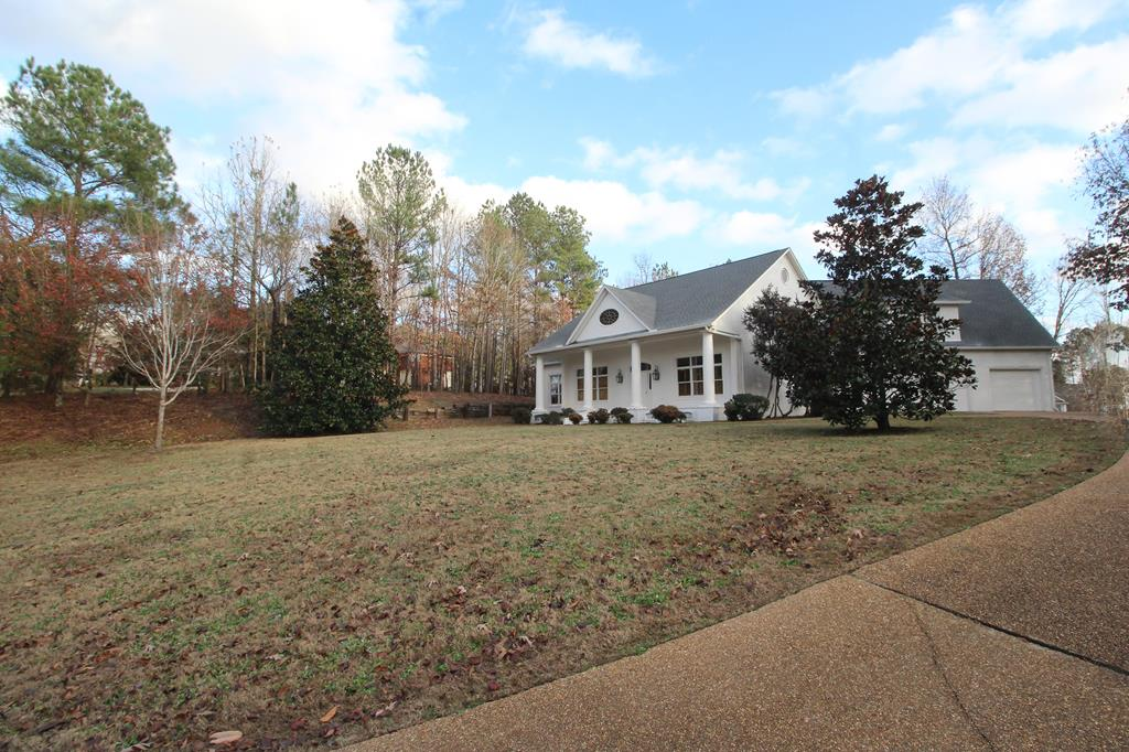 Located on one of the most high-profile streets in the Oxford subdivision of Grand Oaks, this home overlooks hole 17 of The Oxford Country Club. This custom-built 4 Bedroom/4.5 Bath home has vaulted ceilings with wood beams. The kitchen has stainless appliances, gas Viking cooktop, granite counters. The large master is on the main level; master bath has double vanities, separate tub and walk-in shower. The main level also includes a formal dining room, a study/office with a walk-through wet bar into the living room that has a gas fireplace. There is also an oversized bonus room w/ a full bath.
