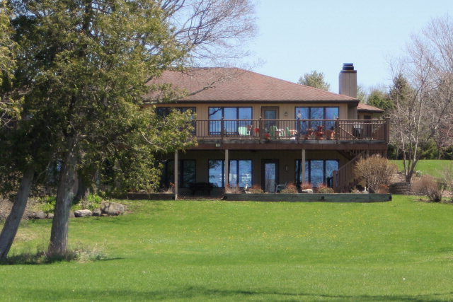 Beautiful waterfront home built and finished with quality materials.  Great for entertaining.  Includes walk-out finished lower level, large Trex composite raised deck.  Additional detached 3 stall garage/workshop.  Professional landscaping.  Too many amenities to list.  A must see!  There are two additional, attached properties for sale, see MLS #123970 & 123984. Listing agent is daughter of Seller.