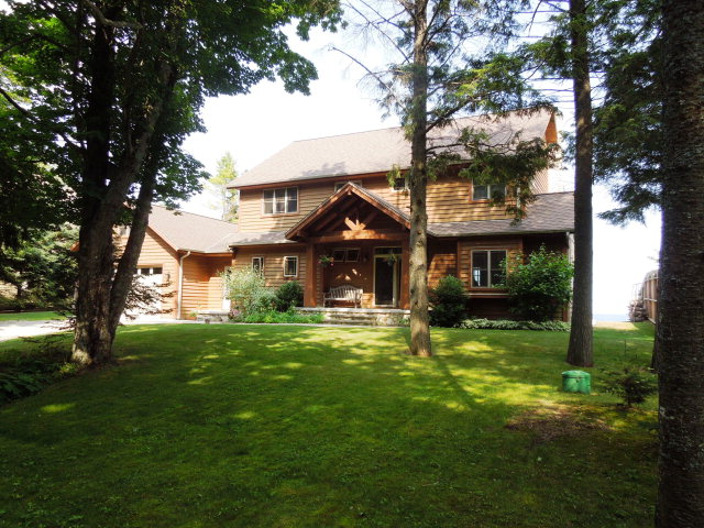 Perfect Door County living in this lovely waterfront home.  Bark Road is widely known for its beautiful sand beach which stretches from Glidden Lodge Resort North to Whitefish Bay Dunes State Park.  The well built(Leist Construction)home features birch hardwood floors, cherry cabinets and solid paneled doors.  A dream kitchen with gas thermador stove, double wall oven, granite and butcher block counters.  Gorgeous Door County stone fireplace and an open concept living area, perfect for enjoying friends and family.  The large, attached 2-car garage features a 3-season screened in rec room overlooking the sand beach & Lake Michigan.