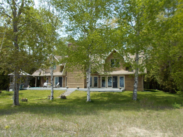 A great home on a great lake!  135 feet of sand beach on the Lake Michigan shore in a quiet area just 5 miles south of Sturgeon Bay.  Impressively designed by Henry Isaksen with cathedral ceilings and a two-story massive stone fireplace.  First floor spacious master with sitting area and amazing water views. Enjoy outdoor conversation in a screened gazebo or gather around the campfire. Large office area and bonus room on second level offer opportunities for additional bedrooms.