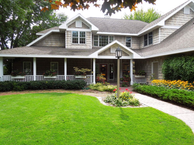 Spacious, custom built home on Sturgeon Bay waters.  Lush landscaping with in-ground sprinklers.  Working harbor views with gorgeous sunrises and sunsets.  Two story tall great room with wall of windows facing the water.  Pella windows.  Extra rooms include breakfast nook, walk-in pantry, finished bonus room, his and her walk-in closets and sitting area in master suite.  Permanent 80 foot dock with full power and water.  In-ground pool with electric power. Updated wood flooring in 2013.