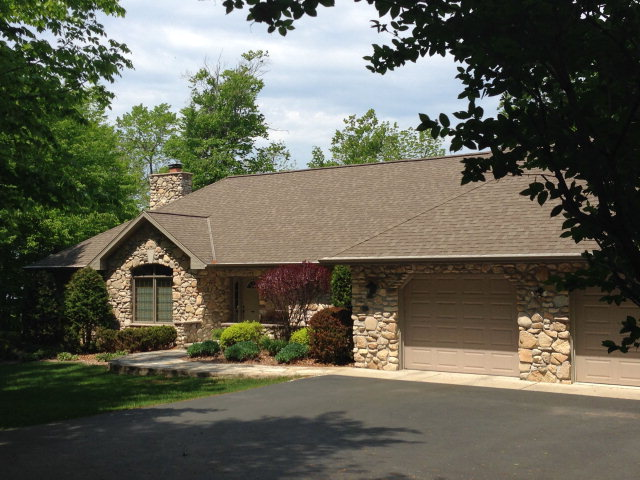 Fantastic water views from every window facing the Bay from this 4-bedroom, custom-built ranch home nestled on the bluffs!  Formal living room with built-ins and window seat, two-way fireplace between dining room and great room, hickory wood flooring, corian counter tops in the kitchen.  Lower level is finished and offers extra storage and walk-out access.  Backup generator.  This very special home is in immaculate condition inside and out, a must see.  Priced to sell.