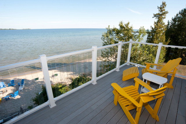 20 Unit motel with owner's apartment located on the waters of Lake Michigan.  Downtown Baileys Harbor.  147 feet of sand beach.  Leased LP tank.  Shared well.  Business up 30% from last year.   Sewer system is pump station.