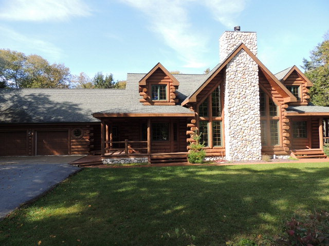This stately and luxurious log home commands a strong presence in the woods along Glidden Drive.  An inviting floor plan welcomes your family and guests yet allows for your own personal privacy in the first level master suite.  Plenty of room to gather together for meals with expansive living spaces on both the first and the lower levels. The access to the lakeside is by way of a private lane deeded for Drive residents only. Quality finishes are noted throughout this executive home. A vacation getaway or your primary residence?  You decide.