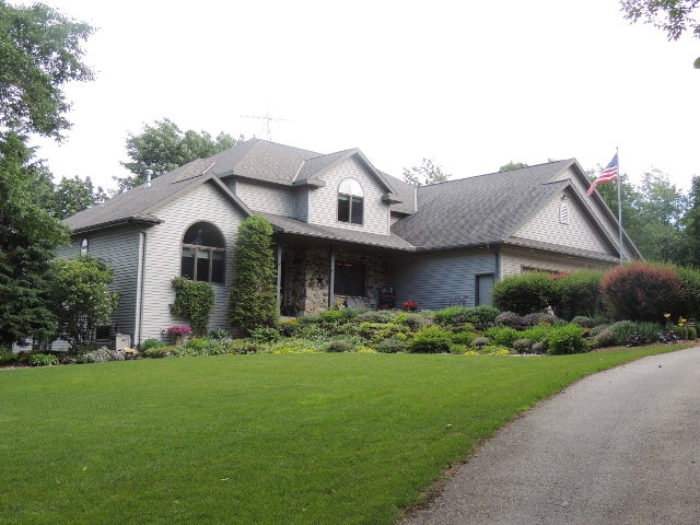 The beauty of this property starts as you drive up the tree-lined driveway.  Entering the home, French doors to the right open into an office area.  The kitchen has maple floors with birch cabinets and solid surface counters with under cabinet lighting.  Open living concept from kitchen through dining and living rooms invites conversations.  Large master bedroom and bath, a half bath and a laundry room complete the first level. A loft, 3 bedrooms, full bath and 398 SF bonus room are on the 2nd level. The lower level has a family room to envy. Outside, the rock gardens are flowing with perennials, the patios offer additional entertaining spots and the 36 x 66 workshop has 14' side walls & 12' overhead doors.