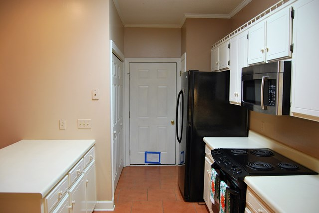 Kitchen to Garage, Laundry on Left, Pantry, beyond