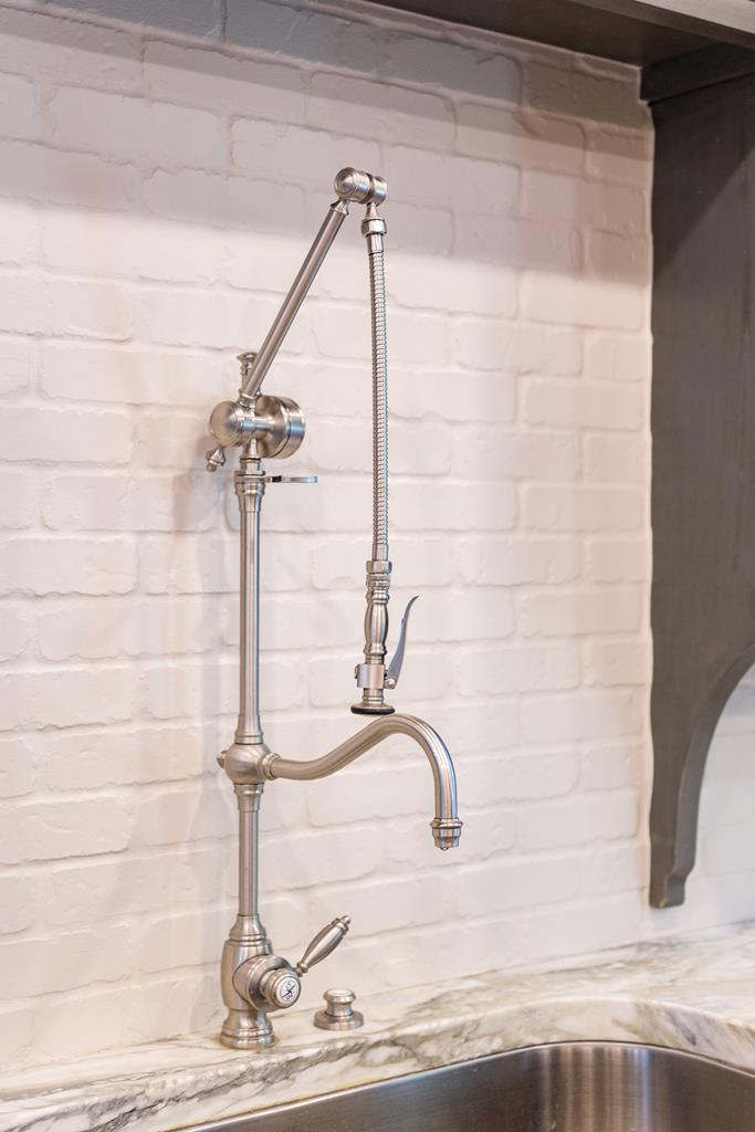 Wall mount sink in kitchen