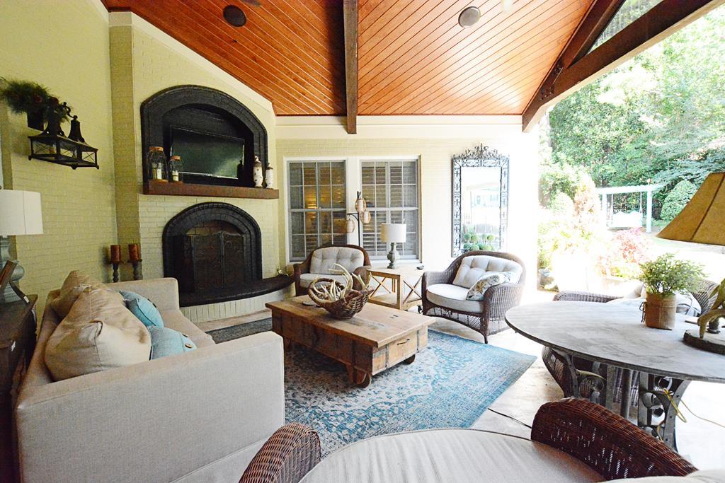 TV above mantle w/ fireplace below.