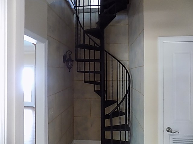 IRON STAIRS IN HALL