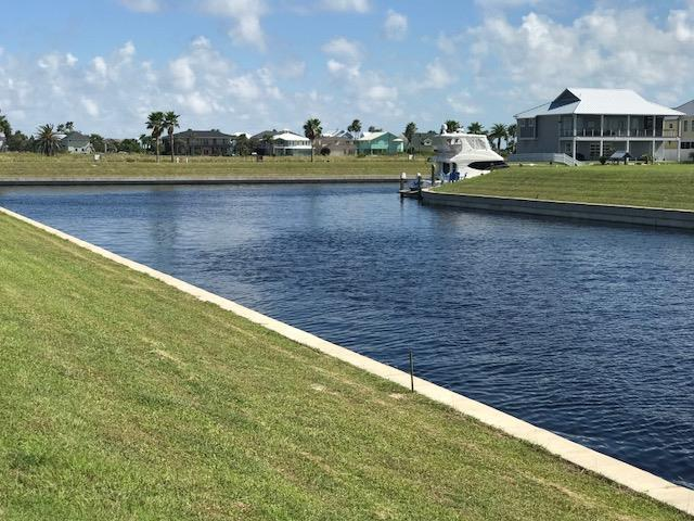 LIFE IS SHORT, BUILD THE BAY HOUSE! This beautiful lot is in the gated community of Islands of Rockport. It has amazing water views and boasts 84 feet of water frontage. Not to mention its right off the inter-coastal waters. This East facing lot will give you days of breezes & evening shade. The Nature preserve is across the street, so it will provide tranquility for owners. Fishing in Estes Flats and Redfish is just moments away by boat or jet out to the Gulf for a day of deep sea fishing. Walk down to the community pool & club house - just 5 houses down. Its the best priced lot for an EAST FACING choice! Owner currently has set of house plans designed for the lot. Owner willing to give plans to new buyers.